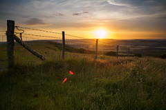 (drfugo) Tags: light sunset england grass fence sussex countryside contrail hills explore flare barbedwire canon5d southdowns lewes firle explored firlebeacon sigma28mmf18exdg