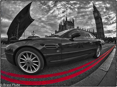 Aston La Vista BigBen (BrassFlute) Tags: england london unitedkingdom bigben fisheye astonmartin westminsterbridge housesofparliment doubleredlines olympusomd 365the2012edition28082012day241