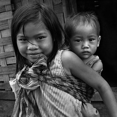 Laos ~ A young girl and her brother (Mei's Photography) Tags: trekking villages laos ethnic 2012 luang blackdiamond prabang panasonice flickraward platinumheartaward flickrtravelaward dmc~gf1