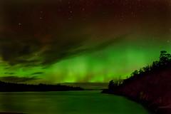 Aurora Borealis (ulfbjolin) Tags: sea sky seascape reflection green water night finland stars aurora northernlights auroraborealis geta land