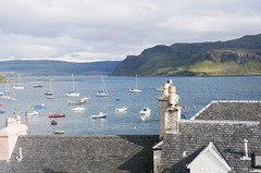 Over the rooftops of Portree. (Trapac) Tags: uk autumn skye water digital boats scotland nikon rooftops isleofskye harbour slate portree chimneys 2012 wmh nikkor3570mm d700 nikond700 flickrcollectionongetty tracypackerphotography wwwtracypackercom gettymomentcreativecollection