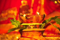 Let it glow, the lights of tradition! (mukesh.barnwal) Tags: marriage lights red traditions india leaves diyas flames puja ceremony ethnic beauty beautiful