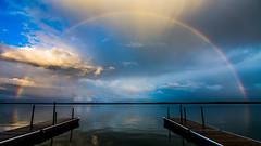 Lake Bemidji Rainbow (Jacob Laducer) Tags: rainbow lake bemidji minnesota water sky clouds rain skyline reflection