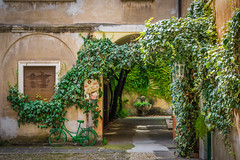 Courtyard Brescia Italy (Vic Zigmont) Tags: courtyard bicycle bike green bresciaitaly architecture oldbuilding italy