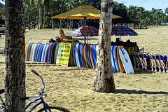 Boogie Boards for Rent (AntyDiluvian) Tags: hawaii 2001 30thanniversary oahu honolulu waikiki beach boogieboard rental bike bicycle