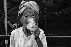 The People of Inle Lake - Myanmar (virtualwayfarer) Tags: myanmar burma burmese southeastasia indietravel traveling explore exploring inle inlelake nyaungshwe nyaungshwetownship daytour boattour budgettravel authentictravel people peopleofmyanmar local locals dailylife shanstate oldwoman portrait woman beauty beautiful street smoke smoking charming unhealthy longlife badass travelphotography travelphotographer canon dslr lightroom natgeo natgeoinspired