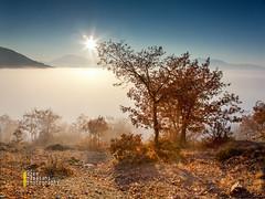 walk into the fog (azem) Tags: above city sunset sea sun mountain nature silhouette fog canon landscape eos star shadows walk scene calm hills prizren kosova kosovo layer 5d balkans idyllic tranquil markii