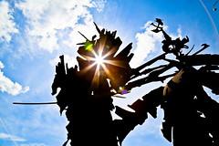 The Refract-O-Rator (TW Collins) Tags: light sky sculpture metal clouds rainbow rust steel lensflare refraction passage sculptor modernist oxidized albertpaley sharpulator refractorator