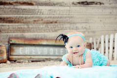 My favorite from yesterday... (harpazo_hope) Tags: wood light portrait baby girl fence necklace natural feather 1750 tailgate pearl tamron vc headband cheverolet d90
