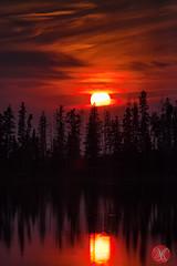 Through the clouds (Kasia Sokulska (KasiaBasic)) Tags: park trees sunset sky sun lake canada clouds reflections landscape island national alberta elkisland nationalgeographic astotin