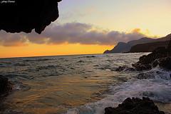 Atardecer en Cabo de Gata (Ferny Carreras) Tags: sunset sea sky espaa sun sol beach water clouds atardecer mar spain agua rocks waves oleaje playa cielo nubes olas almera cabodegata rocas mediterrneo nwn parquenatural oltusfotos