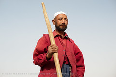 Farmer portrait (Alex Treadway) Tags: red portrait people food afghanistan man male hat proud rural standing work beard asian outside o