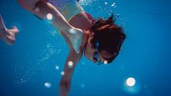 Water games. (yavaro) Tags: blue red pool girl children sony kitlens e1855mmf3556oss nex7 insidewather