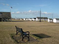 Benchmark - Walmer, Kent (jcbkk1956) Tags: walmer deal seafront thestrand nikon coolpix4300 bench beachhuts afternoon shadow worldtrekker