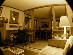 Comfort Zone (Melinda Stuart) Tags: livingroom country passthrough chair column lamp light house fisheye cottage bungalow books chairs couch sitting wood windowframes