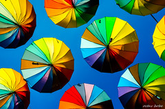 the colors of a beautiful dream (Octav Bobe) Tags: color dream beautiful daydreaming umbrella catchycolors saturatedcolor circle slices sky blue colorcombinations rainbow outdoor