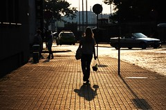 On her way home (mkorolkov) Tags: street streetphotography sunset lady woman shadow walk walking sidewalk pavement evening candid contrejour fujifilm xe1 xc50230
