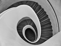 Black Hole Sun (Douguerreotype) Tags: monochrome spiral buildings city bw uk geometry gb england british blackandwhite mono stairs urban architecture geometric london britain helix steps