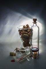 Like a lot of wine drunk ... (Alexander Pugatschewski) Tags: still object cork glass background light bottle bowl brand wine drop red lettering drawing uneven slick reflection shadow transparent lens exakta