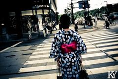 Woman wearing a Yukata 1/3 (ZKent.Yousif) Tags: yellow tkyto japan jp chiyodaku  chku  minatoku canon sigma sigma1750mm 50mm streetphotography street people person yukata