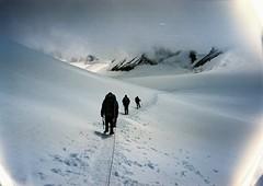 (Nikolay Kulivets) Tags: 35mm film olympusmjuii mjuii kodak georgia clouds kazbek caucasus alpinism rope people man snow landscape mountain glacier fog trail