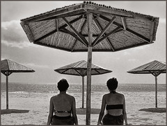 A place in the sun (rogermccallum) Tags: beach sun sunshade sunshades sea seashore girls silhouette