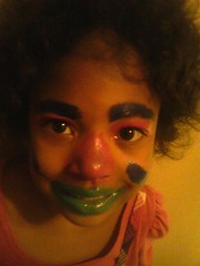 Female child with clown makeup