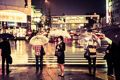rainy days (laffaff) Tags: leica travel wet rain station japan umbrella bag japanese waiting shinjuku warm crossing phone f14 rail rangefinder skirt days business rainy transparent japon tone regen 2012 tokio m9 japaner japanisch