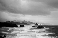 of all the churning random hearts (after october) Tags: ocean sky blackandwhite bw film beach clouds oregon 35mm coast waves trix shore pentaxk1000 pacificnorthwest coastline cannonbeach ecola seastacks ecolapark lyricsfromsealegsbytheshins