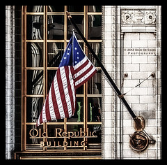 Old Republic Building (Far & Away (On assigment, mostly off)) Tags: park city usa chicago reflection building art history classic window glass architecture america skyscraper illinois view flag united unitedstatesofamerica north windy grand millennium american revolution frame highrise states symbolism betsyross estadosunidos eeuu 13star