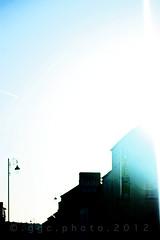 the school run... early in the morning... (ggcphoto) Tags: school ireland sky sunlight silhouette hotel morninglight streetlights bluesky run lensflare 60mm sonyalpha tipperarytown gettyimagesirelandq12012