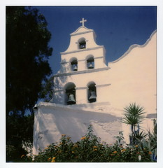 San Diego Mission Bells (tobysx70) Tags: the impossible project tip polaroid sx70sonar sonar instant color film for sx70 type cameras impossaroid bells mission san diego de alcal california ca mater doloroso basilica church cross blue sky tree ogfc polawalk 081116 toby hancock photography