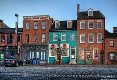 Colorful shops and buildings in Fells Point, Baltimore, Maryland (PhotosToArtByMike) Tags: fellspoint baltimore maryland md thamesstreet fellspointnationalhistoricdistrict historicwaterfront cobblestonestreet waterfrontcommunity rowhouses storefronts 18thand19thcenturyhomes baltimoreharbor maritime