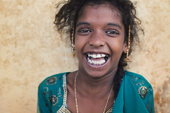 Laughter. Chennai, India (Marji Lang Photography) Tags: canoneos5dmarkii chennai ef247028l india indian indiansubcontinent madras marjilang republicofindia tamil tamilnadu travelanddocumentaryphotography travelphotography atmosphere attitude behaviour bigeyes biggrin blackeyes child childhood chillout color colorful cool cute documentaryportrait eyecontact eyes gaze girl grin happiness happy happygirl horizontalportrait human humanity joy joyful kid laugh laughter look lovely mood moody people positive relaxed slmile smile stare street streetshot teeth tones travel whiteteeth young