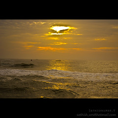 Sunrise in marina beach (Sathish_Photography) Tags: sea sun india beach marina sunrise golden boat early sailing with view rays chennai tamil nadu moning