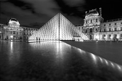 Musee du Louvre (Florin Pantilimon) Tags: longexposure people paris france museum architecture night clouds lights louvre delta olympus musee 400 monuments pyramide ilford zuiko 21mm om1n