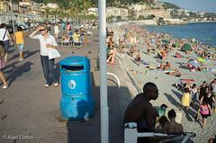 Two Side to Nice (Alan Cotter) Tags: light woman sun man france beach water nice rocks mediterranean stones monaco bin shining alancotter gouganebarragearagh