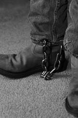 DSC_4949 (jakewolf21) Tags: bw monochrome chains cowboy boots jeans western soles cuffs chained ariat legirons