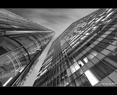 Canary Wharf (Kit Downey) Tags: city uk autumn england blackandwhite bw canada london night canon square lens rebel long exposure cityscape shot angle district low wide perspective bank september tokina eod single wharf kit canary financial hsbc f28 banking barclays citi downey 550d t2i 1116mm