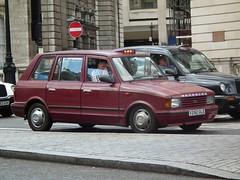 Hooper Metrocab (kenjonbro) Tags: uk red england london westminster trafalgarsquare 1999 hooper charingcross sw1 mcw metrocab kenjonbro fujifilmfinepixhs10 v292gle metrocabiii
