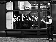 Go Forth (Explore - 20 Sep 2012 - #359) (Peter.Bartlett) Tags: street city people urban blackandwhite man monochrome sign shop walking reading mono newspaper blackwhite candid sony yorkshire text leeds streetphotography scarborough nik shopwindow alpha 700 shopfront westyorkshire explored blackwhitephotos sonyalpha streetphotographyurban alpha700 sonyalpha700 niksilverefex