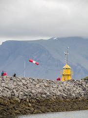 Reykjavik lighthouse (James E. Petts) Tags: iceland reykjavik lighthouse rocks sea seawall windsock