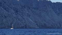 Big Rock Little Boat (Sailor Alex) Tags: boat sailboat sloop vessel sardinia yachting cruising cruisers yacht sea sailing