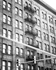 Repetition (Robchaos) Tags: baltimore maryland bw blackandwhite nikon d700 helios helios442 50mm fx city urban abstract reflection pattern repetition repeating cityscape building fireescape windows