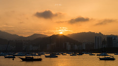 Sunset | Golden Boats (Jos Eduardo Nucci) Tags: southamerica beautiful boats baadeguanabara atmosphere rays sun nikon joseduardonucci photography riodejaneiro olympiccity urca botafogo flamengo landscape beach enseadadebotafogo nucci 28300mm mountains marvelouscity sky passion cloudscape fantastic paradise epic icon classic christtheredeemer sugarloaf sea water brazil bay tourism misty magical sunshine cloudy morning evening season people getty explore stunning flickr favorite goldenhour outdoor leblon ipanema sands copacabanabeach olympic cityscape colors blue yellow dark black silhouette boat serenity peace harmony balance nature