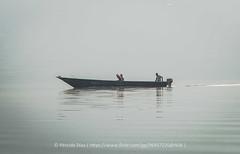sunrise at Bunyonyi lake (persidadiaz) Tags: lake water sunrise river ro bunyonyi uganda africa boat barco amanecer calma calm scenery landscape paisaje mirrow relfejo reflections country light fog foggy mist