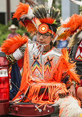 Native American Dancer (wyojones) Tags: wyoming cody codystampede rodeocapitaloftheworld codystampedeparade 4thofjuly smile nativeamerican arapahoe americanindian boy youngman traditionaldress dancers glasses eyeglasses feathers