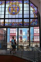 Colourful Bilbao seen from within the Mercado de la Ribera (RW-V) Tags: canoneos70d canonefs24mmf28stm bilbao euskadi espaa baskenland basque paybasque spanje mercadodelaribera mercado market stainedglass vitrail gebrandschilderdglas 80faves 100faves 120faves
