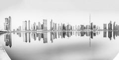 Business Bay (gurkendoktor) Tags: dubai samyang panorama pano fujifilm xe1 blackandwhite bw reflection mydubai uae architecture skyline skyscraper