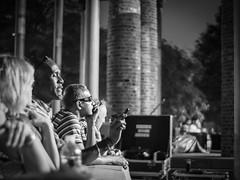 Night Concert (bradmo) Tags: street nyc newyorkcity blackandwhite bw newyork concert manhattan voigtlander olympus nokton batteryparkcity omd 25mm rockefellerpark 095 em5